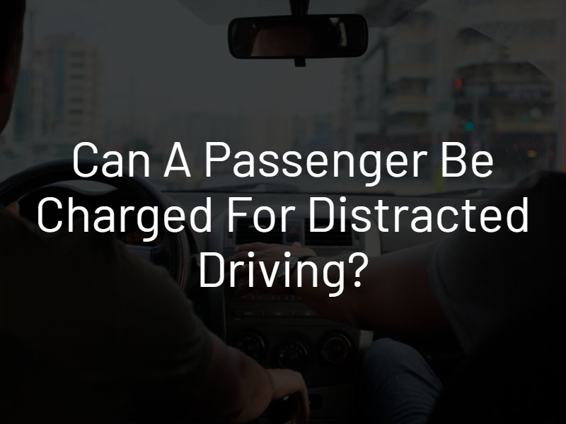 passenger charged for distracted driving